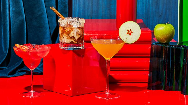 Pumpkin Spice White Russian, Blood Orange and Pomegranate Margarita and an Apple Martini on a colorful background