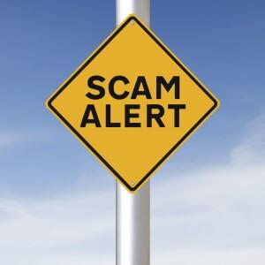 yellow diamond warning sign saying scam alert