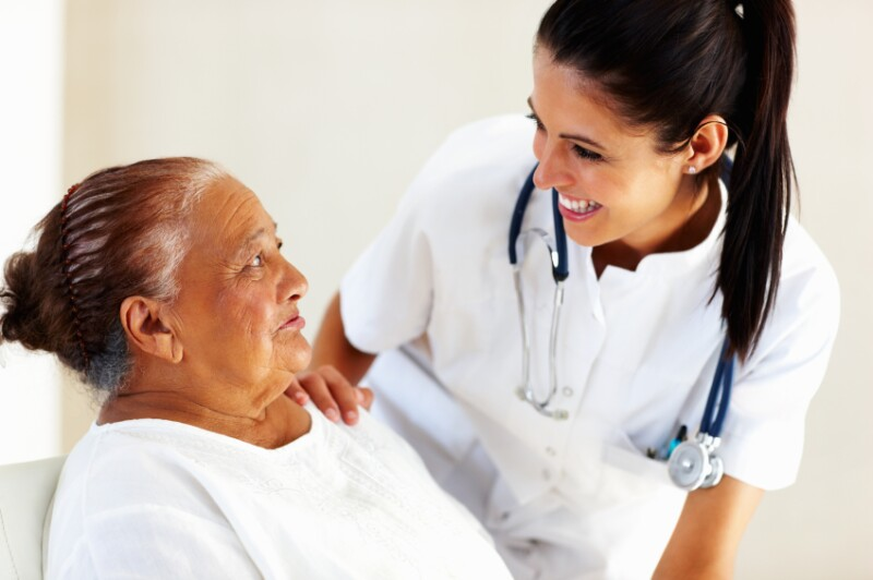 Doctor talking to older woman patient