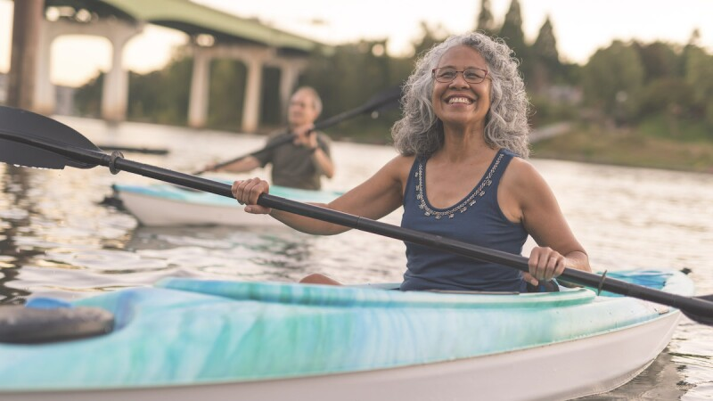 silver-haired woman kayaking