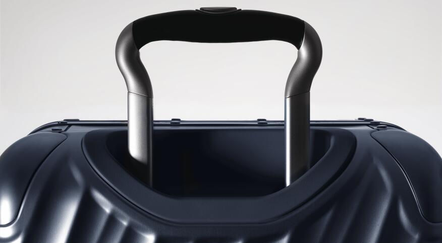 Dramatically lit suit case and handle