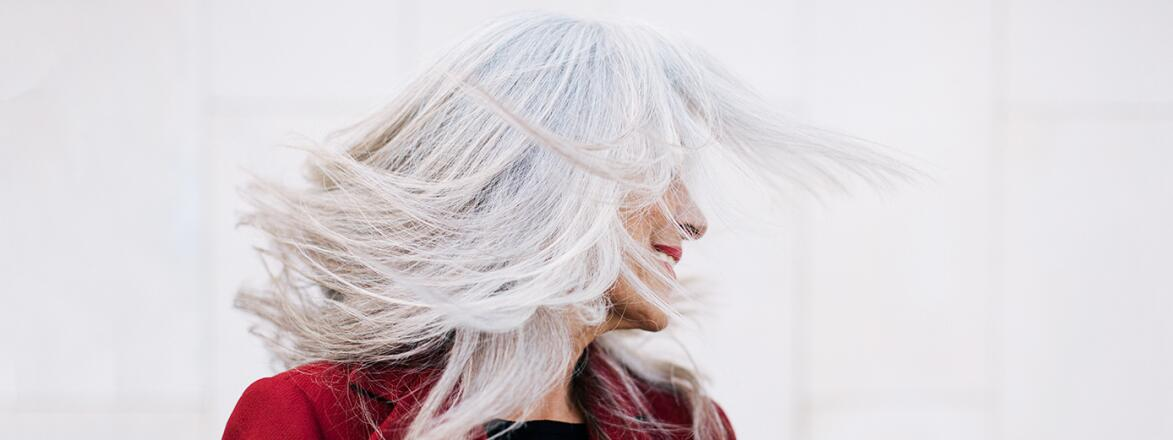 An image of a woman with long gray hair.