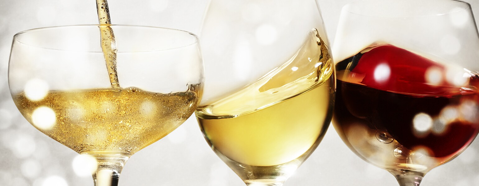 An image of three different holiday wines in wine glasses.