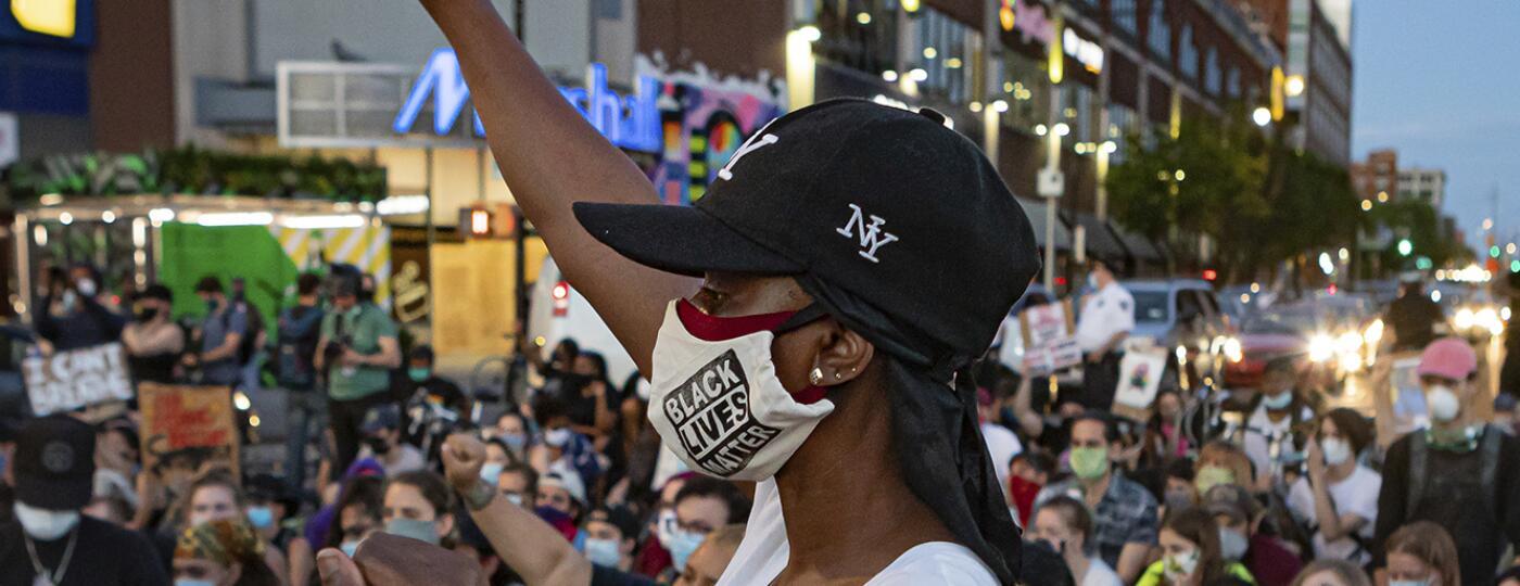 Black_woman_center_BLM_protest_1500_AP_20159530987740.jpg