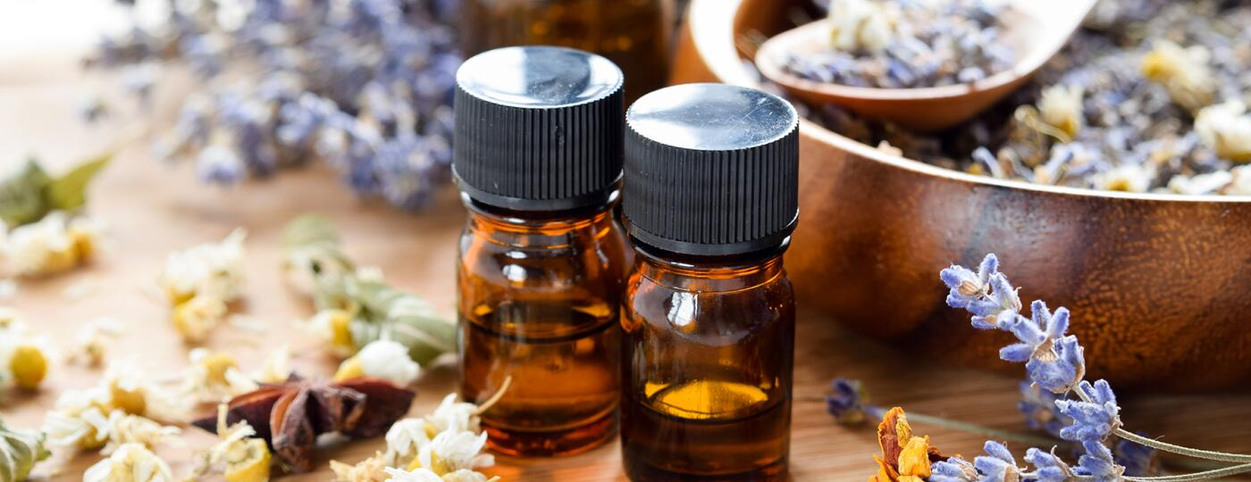 image_of_essential_oil_bottles_and_dried_flowers_GettyImages-546775666_1800