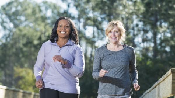 Two women speed walking