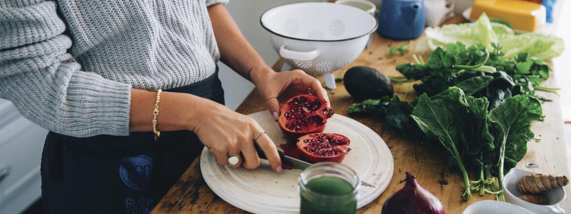 woman cutting a pomegranate