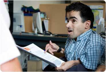disabled working man holding report