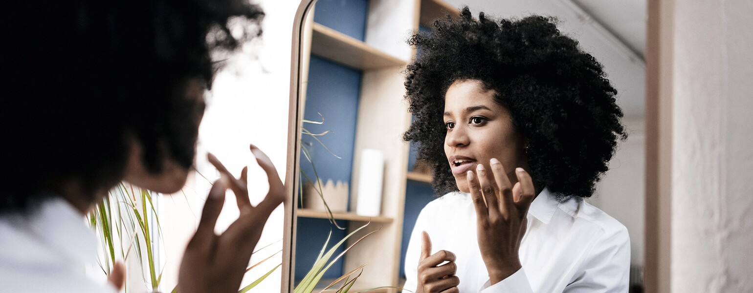 image_of_black_woman_chceking_face_in_mirrors_GettyImages-735932625_1540