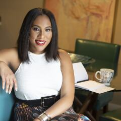 Lifestyle journalist Dontaira Terrell shown sitting at a table