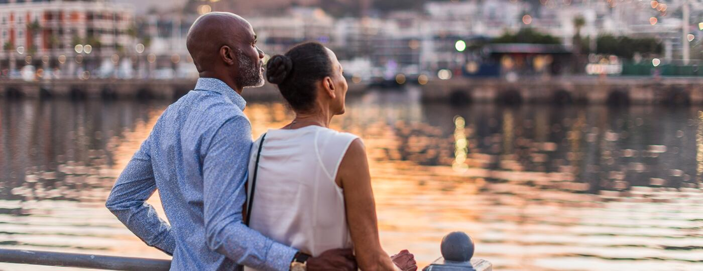 image_of_man_and_woman_from_behind_gazing_out_at_water_GettyImages-1234228119_1800