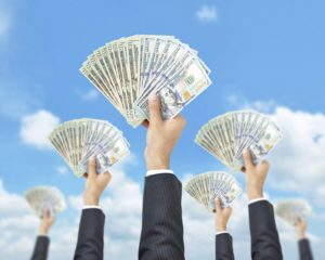 Crowdfunding hands holding up money