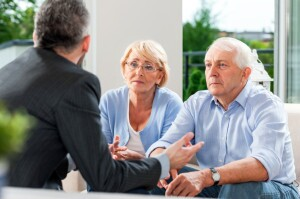 Retiree couple getting financial advice