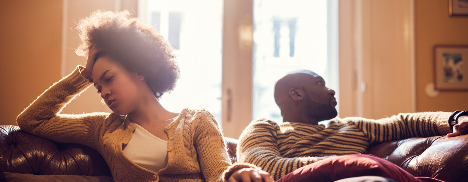 photo_of_upset_black_woman_on_couch_with_black_man_GettyImages-485953996_1540