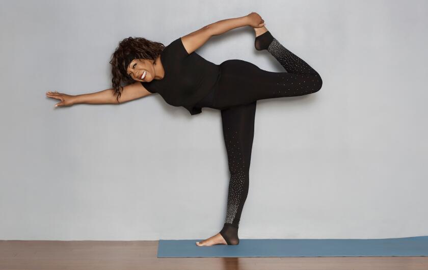 Mary Wilson doing yoga
