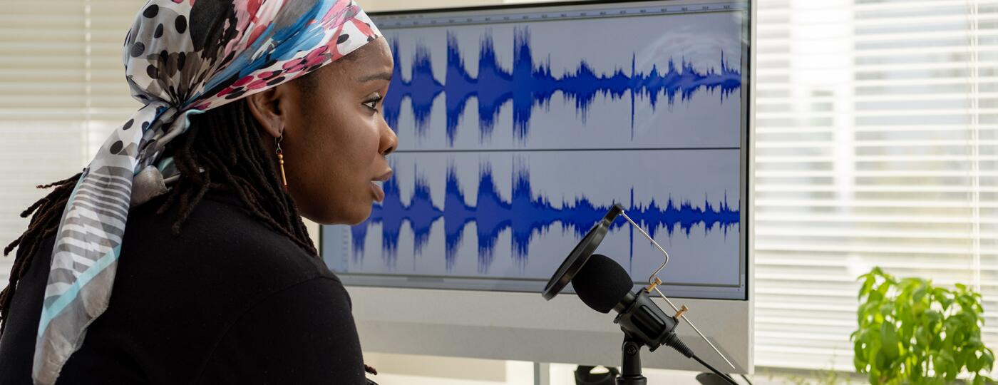image_of_woman_in_front_of_computer_and_mic_recording_podcast_Stocksy_txp2fcf3872cNw200_Large_2830503_1800