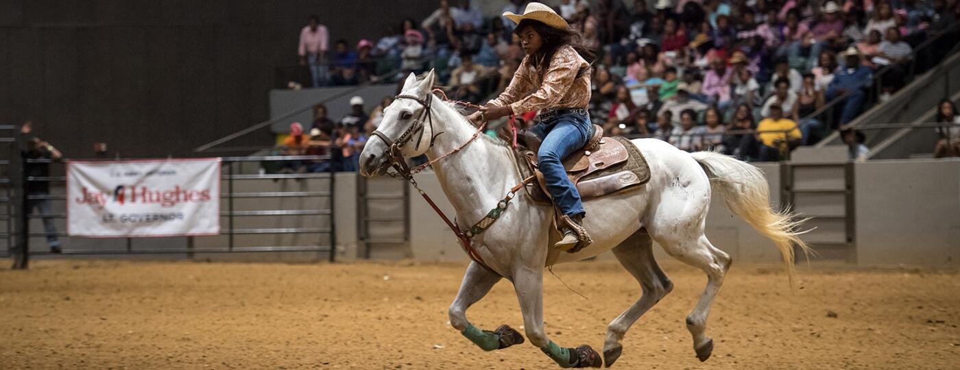 image of black cowgirl on horse by rory doyle
