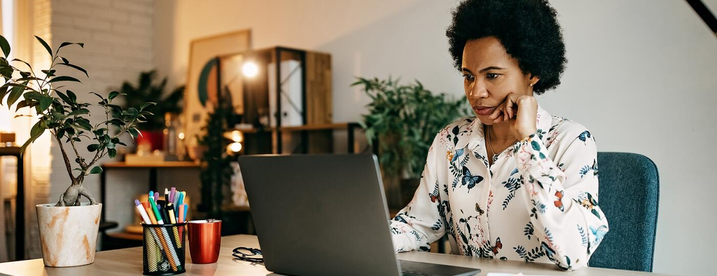 image_of_woman_working_on_computer_GettyImages-1216489414_1800