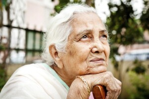 One sad pensive senior Indian woman