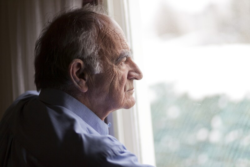 Man gazing out sad profile