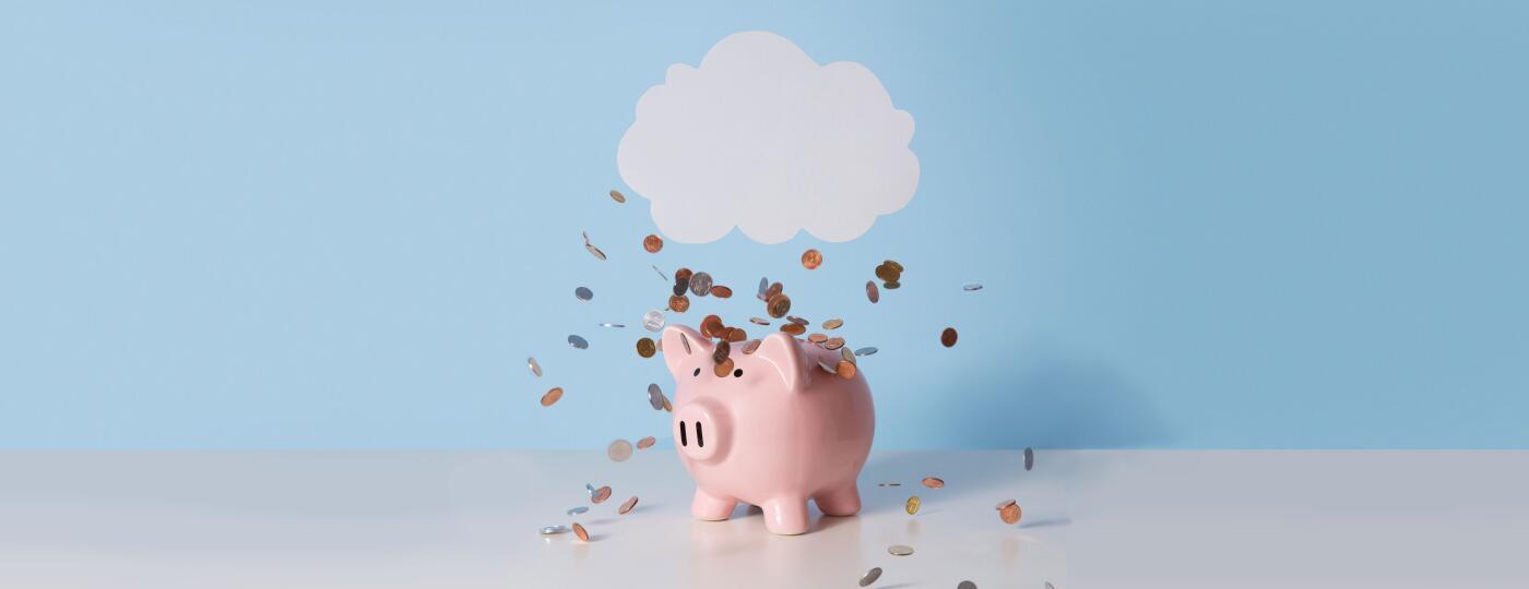 Cloud raining change onto a piggy bank