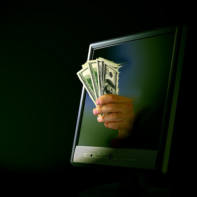 money coming out of computer screen