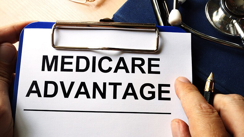 Medicare advantage written on a clipboard