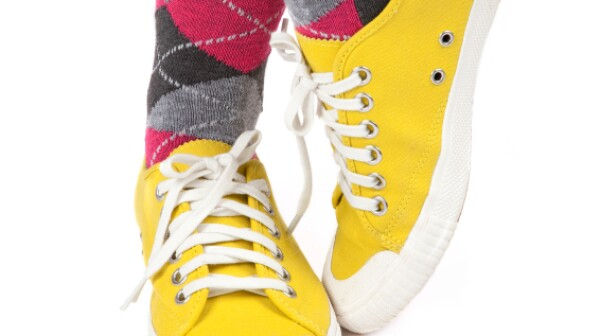 Coloful knee-high socks and sneakers