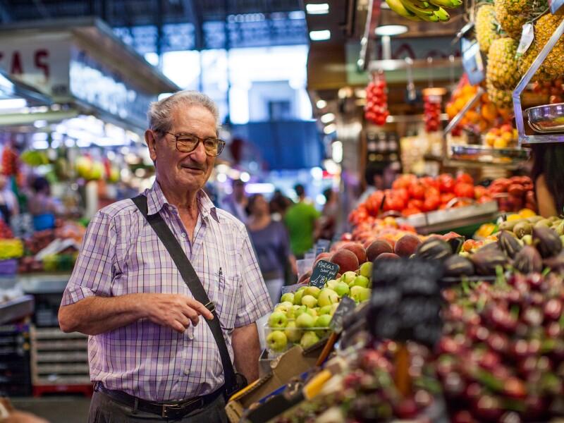 Older man buying groceries