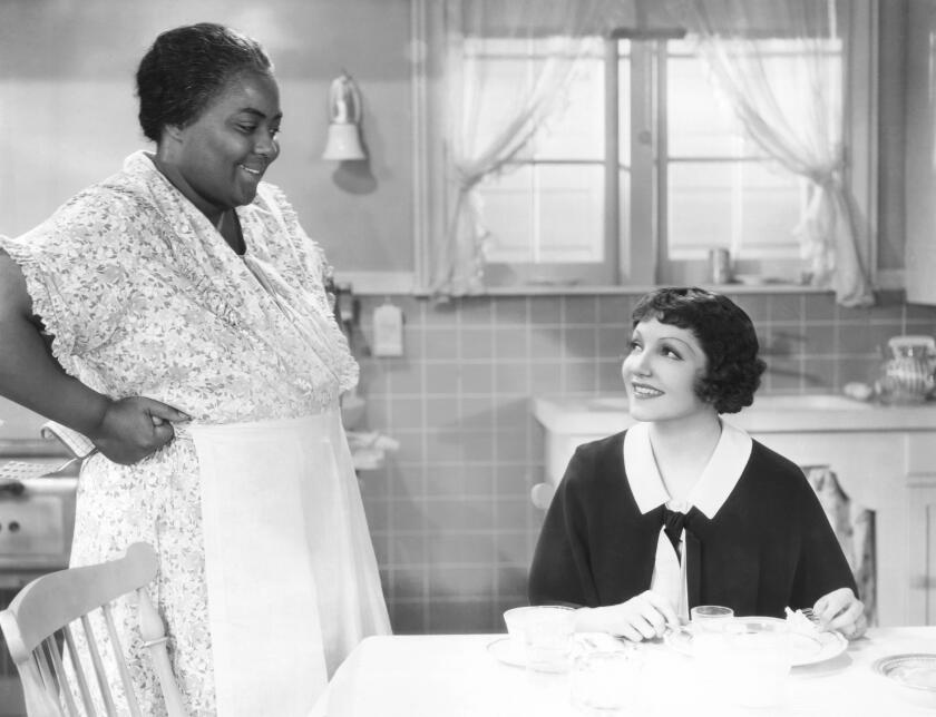 IMITATION OF LIFE, from left: Louise Beavers, Claudette Colbert, 1934