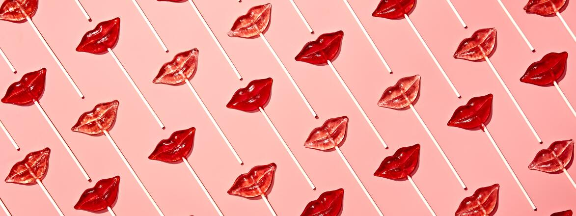 lip shaped suckers on a pink background
