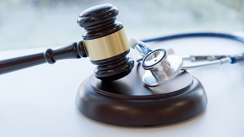 A gavel and a stethoscope