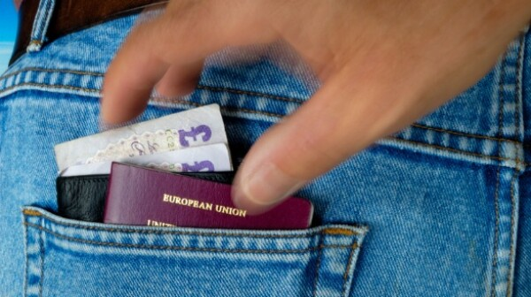 Pickpocket in action - Wallet and passport.