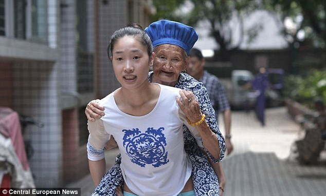 Chinese woman carrying her grandma
