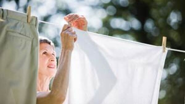 Woman hangs laundry on a line