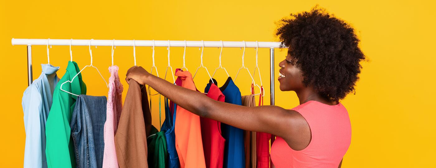 image_of_woman_looking_through_clothes_on_rack_shutterstock_1949795689_1800