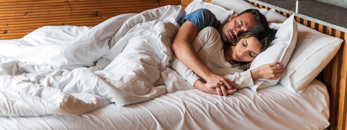 loving couple sleeping in bed
