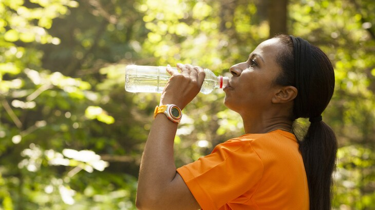 image_of_woman_outside_drinking_water_bottle_GettyImages-647249888_1800