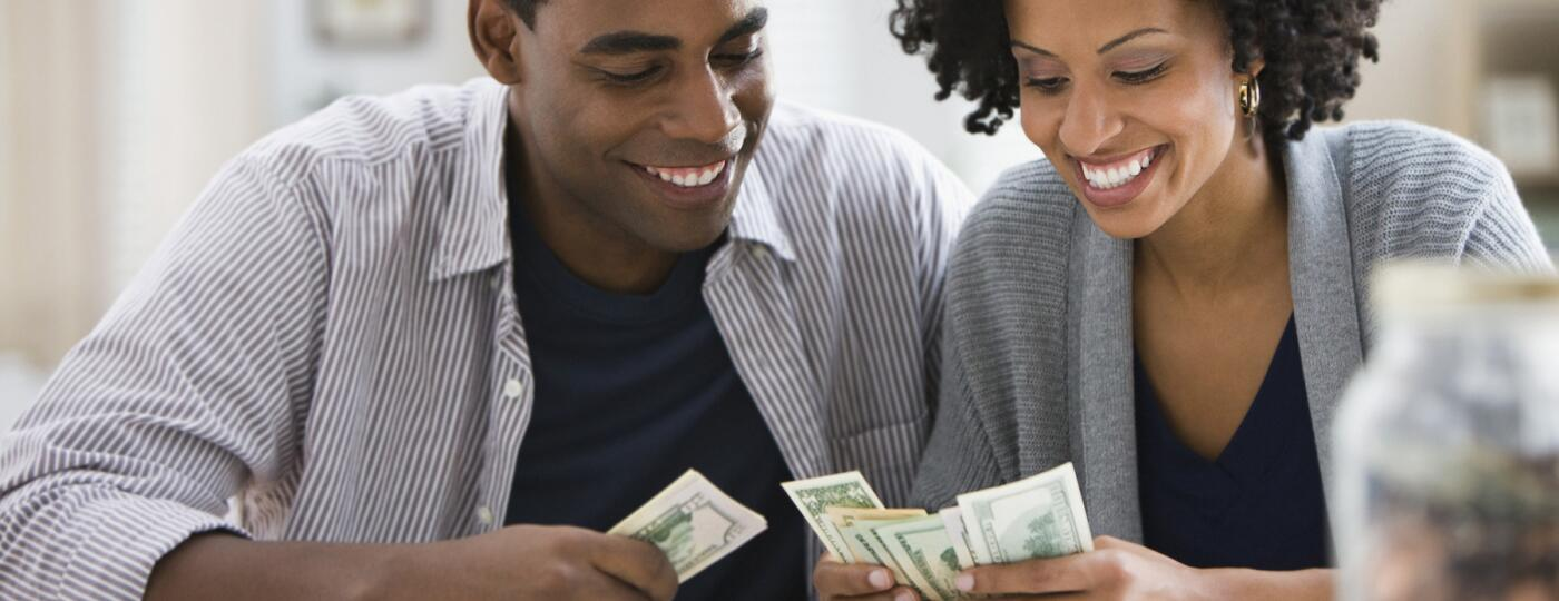 image_of_man_and_woman_counting_money_GettyImages-103919680_1800