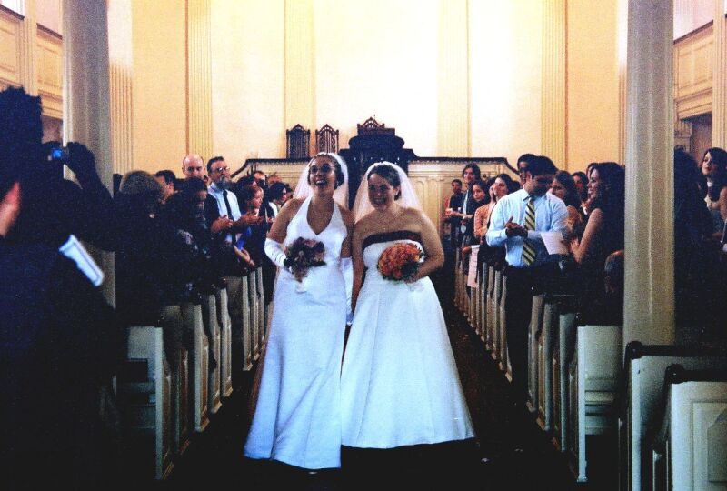 Two women in church getting married, gay marriage
