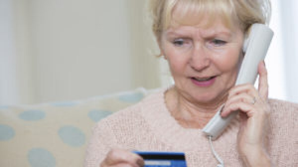 Older woman giving credit card info over the phone