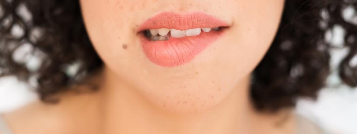 Up Close Of A Woman biting her lip