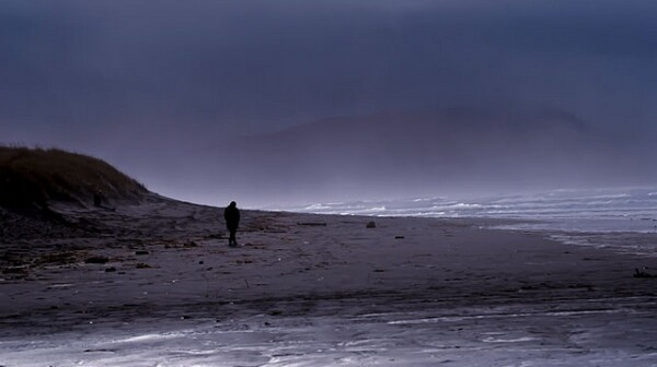 lonely man on beach