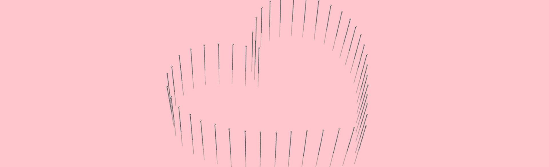 illustration of heart symbol with  acupunture needles