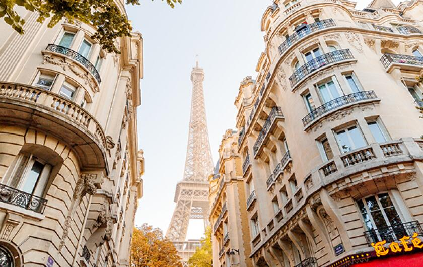 Eiffel Tower seen in the end of the street in Paris, France