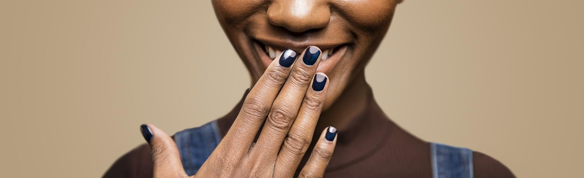 Women with hand in front of her face showing her manicure