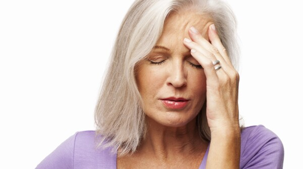 Senior Woman Suffering From Headache - Isolated
