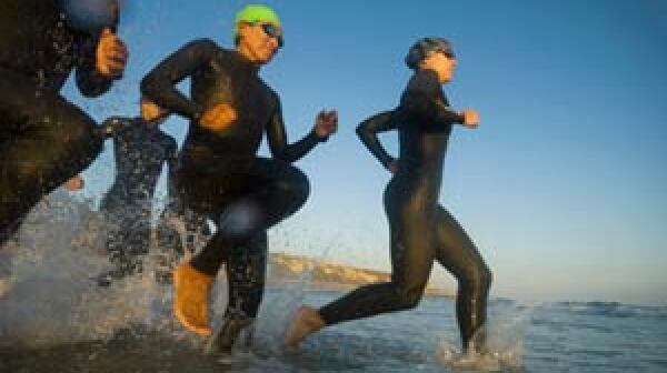aerobic exercise is more effective at reducing harmful belly fat than weight-resistance exercises- mature people running into the surf