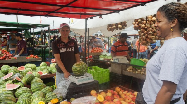 Woman shopping on farmer's market in San Jose, Costa Rica