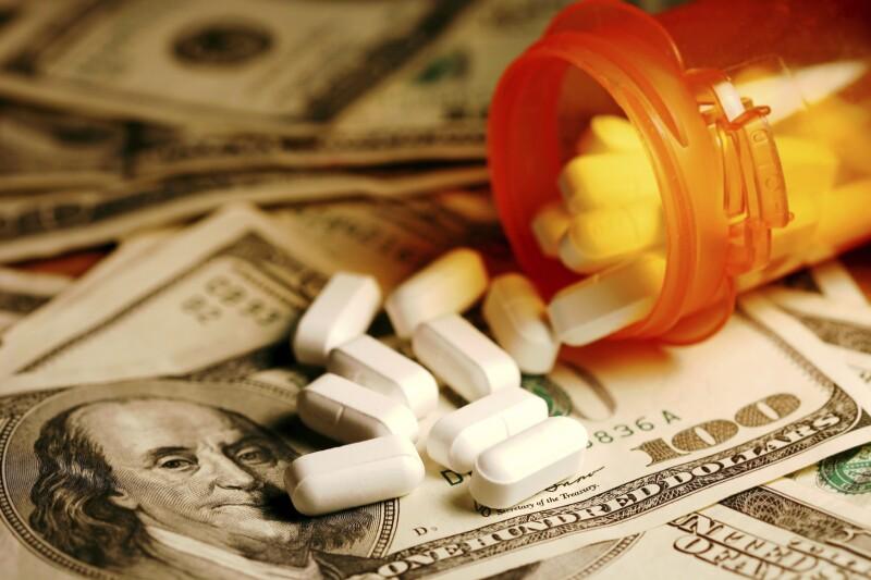 Prescription drugs on a hundred dollar bill